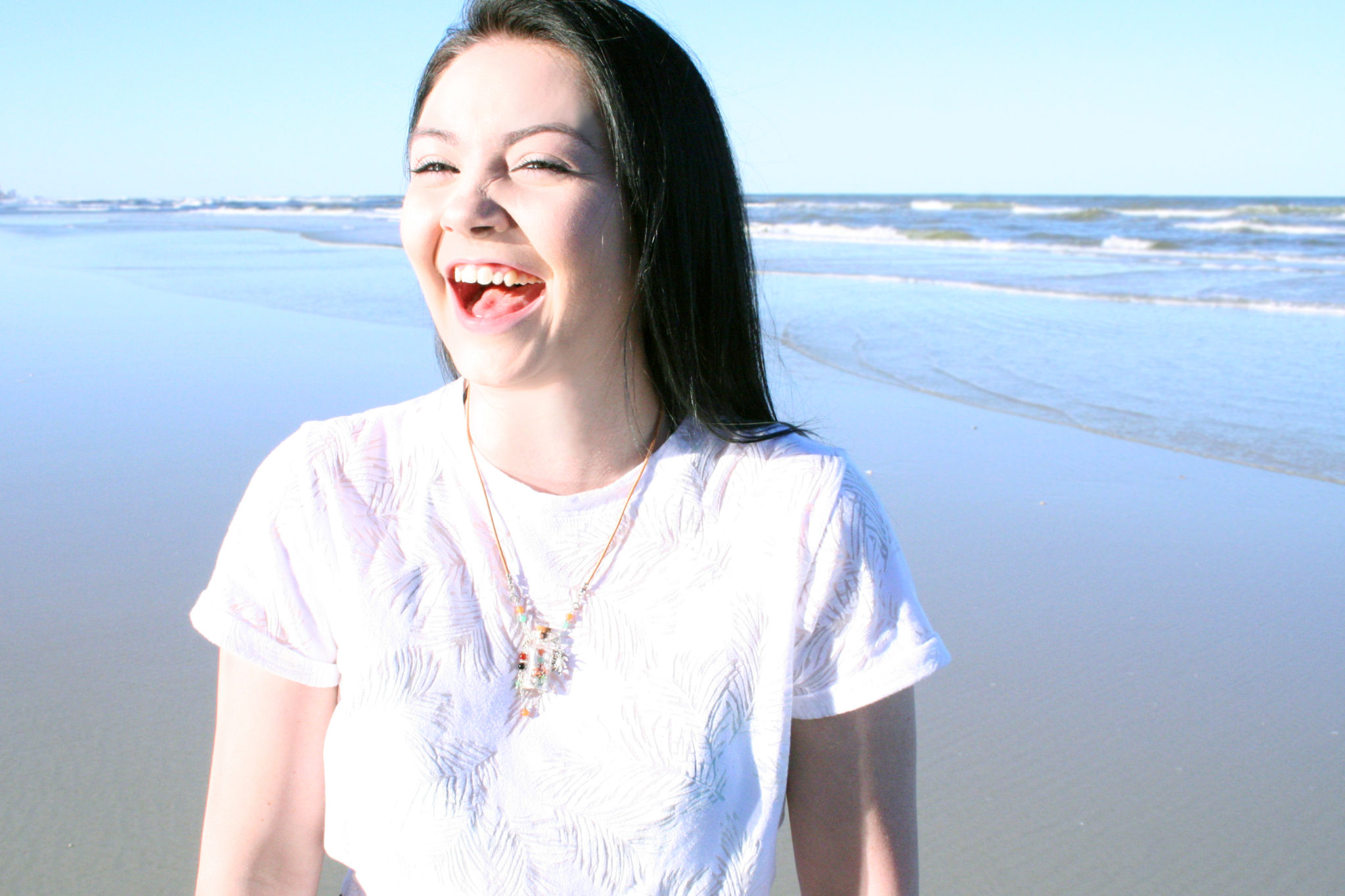 Laughing girl wearing Gidget's Getaways Beach in a Bottle