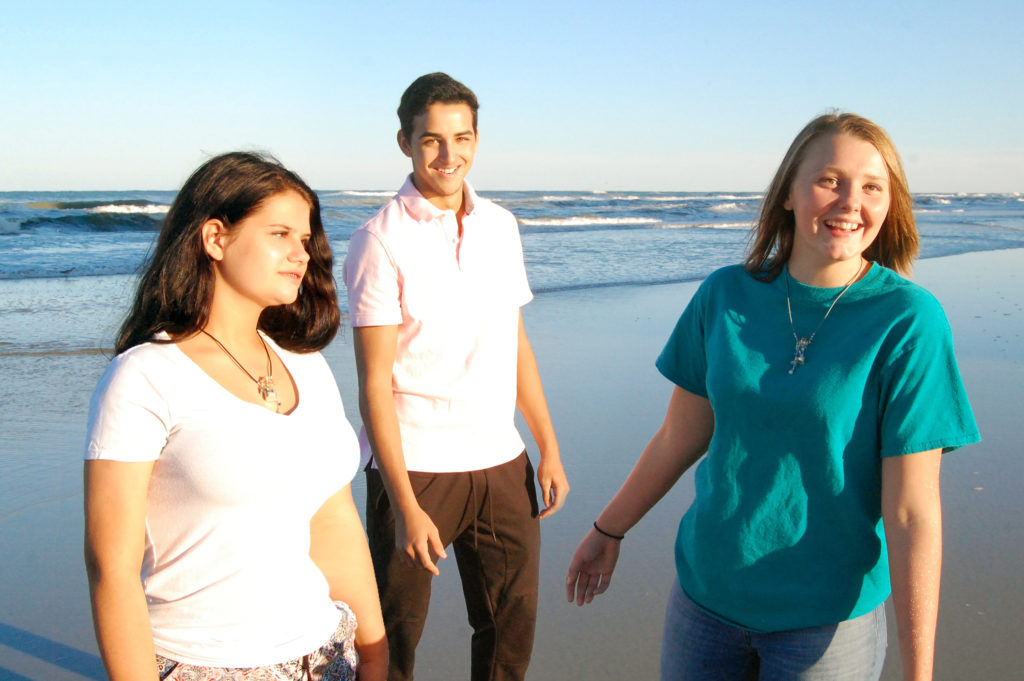 Friends laughing wearing Gidget's Getaways Beach in a Bottle Necklaces